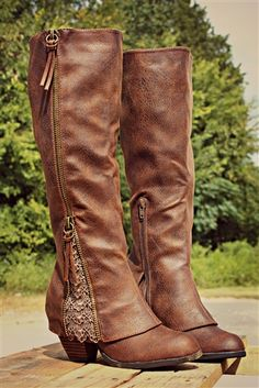 Our Sassy Classy Riding Boots in Tan are ADORABLE!They are a synthetic leather on the exterior with a super soft microfiber interior and double zippers. They feature detailing throughout with a 'fold over' design near the ankle with lace detailing at edge