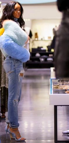 God bless, Rihanna. Multi-colored pasted fur with blue jeans.   //Pinned on @benitathediva , LifeSTYLE Blog