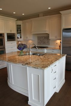 dark floors, white cabinets, in the middle granite