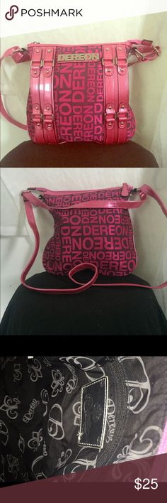 Hot pink Dereon cross body! Dereon cross body perfect condition never used! Adjustable straps! Make an offer! Dereon Bags Crossbody Bags