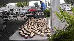 Cupcakes and a beautiful logo cake! World Kitchen ..Blue Heron Events & From Scratch Catering.