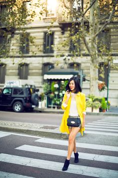 LOCATION: MILAN Red Valentino Shorts and Top and Coat / Mulberry Bag / Jil Sander Boots / Jennifer Zeuner Rings