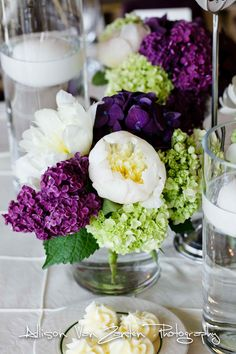 Centerpieces contained deep purple hydrangea, dark purple lilac, white peonies, bright green mini hydrangea, and purple allium Purple Hydrangea Centerpieces, Peonies Centerpiece, Green Hydrangea, Wedding Centerpieces, Wedding Decorations, Wedding Ideas, Wedding Stuff, Peonies And Hydrangeas, White Peonies