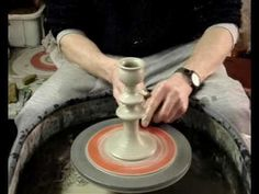 Throwing a candlestick on the potters wheel
