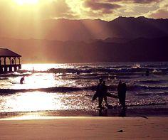 The kids sunset surfing at Hanalei.