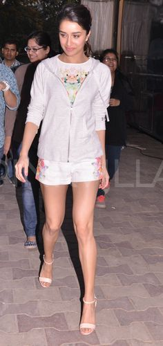 Shraddha Kapoor was recently clicked shooting for a brand advertisement at a suburban studio in Mumbai.  The actress is wearing a floral printed top with matching shorts. A jacket, nude heels and a