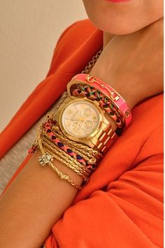 Love the gold watch + touch of color bangles... <3