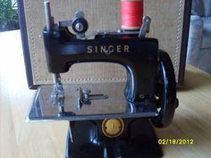 Black Singer toy sewing machine