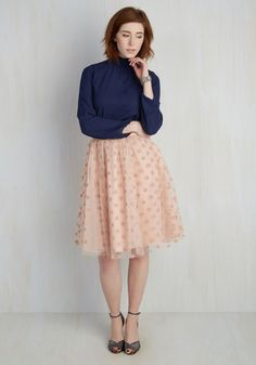 In this stunning midi skirt from Ryu, you propose a toast to having fun with fashion! Textured dots adorn the mesh overlay of this swingy skirt to provide pops of pretty wherever you go. Polished off with a pastel pink hue, this swishy skirt is worthy of a swanky soiree, any day!