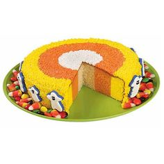 How Candy Corn is Born Cake - Ever imagine How Candy Corn is Born? Here's one explanation! Checkerboard Cake Pan rings are used to bake the 3-color cake layers. When you slice cake into wedges, they'll look like giant pieces of candy corn!