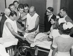 """In this image Dr. Walter Freeman performs a lobotomy at Western State Hospital in Virginia, using an ice-pick-like instrument he invented for the procedure, July 1949. Freeman traveled to 23 states to demonstrate his """"miracle cure."""" In all, he performed some 3,439 lobotomies—some on patients not yet in their teens. Despite the obvious risks and lack of concrete success rates, hospitals let Freeman continue; however, everything changed in 1967, when Freeman performed a lobotomy in…"""