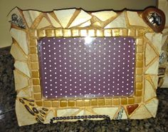 Mosaic picture frame made from the same broken antique platter.