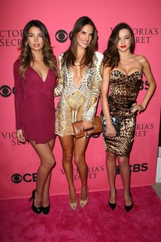 Lily Aldridge, Miranda Kerr, Alessandra Ambrosio at the 2011 Victoria's Secret Fashion Show at Segerstrom Center for the Arts. Kerr is wearing a strapless Dolce & Gabbana dress, Ambrosio is wearing a Balmain dress with a plunging neckline and Aldridge goes colorful in a Gucci gown.