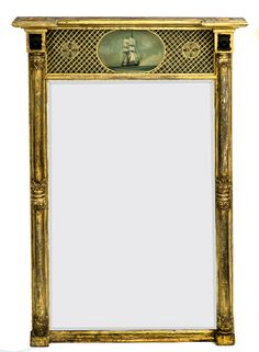 Regency gilded wood and gesso Classical style pier mirror having flanking side columns with acanthus leaf carvings at the top, center and base of the columns, over-hanging cornice, eglomise glass panel with geometric background centered by an oval depicting a ship as its theme with flanking roundels.  The mirror plate is beveled.      English Circa 1810     Height: 45"