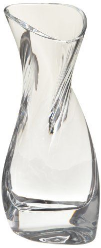 Nambe River Crystal Vase, 4-3/4-inch by 5-1/2-inch by 12-inch by Nambe. $146.51. Hand wash recommended. Designed by neil cohen. Crystal glassware. Pair with river candlesticks. Made to make a table setting jump. The sleek and crystal design that flows like the river catches the light and exemplifies style and grace in the home.