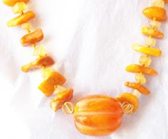 Handmade Baltic Amber,bakelite, & citrine necklace available for purchase at: https://www.thecraftstar.com/product_details/71628/baltic-amber-bakelite-necklace/
