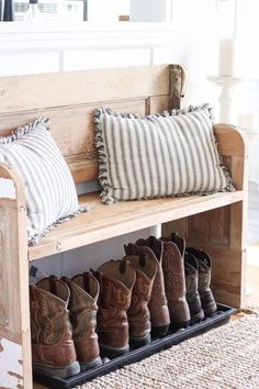 rustic wooden entry bench with boot storage underneath - Step inside this beautiful Indiana farmhouse entryway decorated with a mix of…