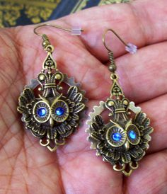 Owl Pendant Earrings (E52-3) - Antiqued Brass Owl Pendants - Brass Gear and Blue Swarovski Crystals not copper but pretty. Hand made one of a kind  $20.00 USD