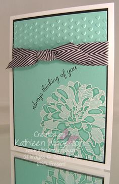 """Stampin' Up! Regarding Dahlias and Express Yourself stamp sets; Whisper White, Basic Black and Coastal Cabana card stocks;  VersaMark and Jet Black StazOn ink pads; 2013-2015 In Color markers; White embossing powder; Big Shot Adorning Accents embossing folder and Basic Black 3/4"""" Chevron ribbon."""