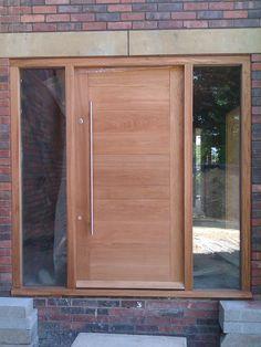 Modern solid oak front door, custom designed for new build. Made by The Bespoke Door Company.