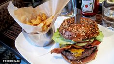 ROGUE KITCHEN & WET BAR - The 9.2 oz ROGUE burger ($12.99) has a large sirloin patty, sesame brioche bun, bacon, cheddar, lettuce, tomato, pickle, sweet relish, and mayo. It also comes with a side of fries. This is one massive burger and it is even skewered together by a knife.
