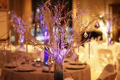 Very pretty crystal and willow-like centerpiece. Whimsical with soft colors.