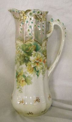 Description                     R S Germany porcelain 11 tankard pitcher with transfer & hand painted applied floral design.