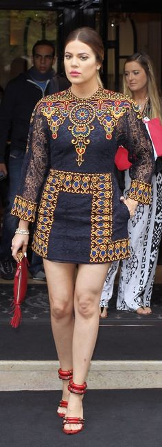 While in Paris before Kim's wedding, Khloé Kardashian stepped out in a colorful patterned Balmain minidress.