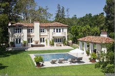 view 1 of 2 :: pretty spectacular backyard with its beautiful pool and poolhouse...