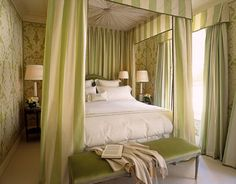 """Fresh and bright and happy"" is how designer Alessandra Branca describes this Chicago master bedroom. ""The stripes are green silk and white wool, and light moves through those materials in different ways. It creates another layer of pattern against the walls."" Antique glass lamps are on vintage ebonized Jansen bedside tables."