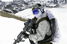 US Navy SEAL sporting a juicy setup during wintertime mountain training