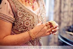 Gold bangles with hand chain and rings via IndianWeddingSite.com