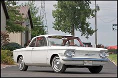1960 Chevrolet Corvair Monza - Not sure what year or style my Grandmother had, but she would drive, what seemed to me, a million miles an hour down at the lake with all the extreme curves and hills.  She was CRAZY!  It was a white Corvair with red interior, loved it.