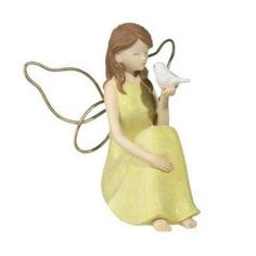 Fairy with Animal www.teeliesfairygarden.com This lovely fairy is loved by all animals. She always makes time to play or talk with them. #fairyanimal