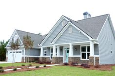 """For the siding, I chose Dovetail by Sherwin Williams which is a really beautiful cool gray with slight blue undertones.  The trim and vinyl soffets are Linen.  I wanted to create an eye catching contrast between the siding and the stone so I chose a very warm colored stone called Pennsylvania by Centurion.  The stone is a """"ledge"""" style which gives it a more rustic look.  This contrast between the cool siding and the warm stone is striking.  For the door, I wanted to have some fun and add my…"""