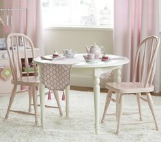 Would love to find a small table and chair set like this to put in Mabel's big girl room, beside a kitchen set.  Tea party, anyone?