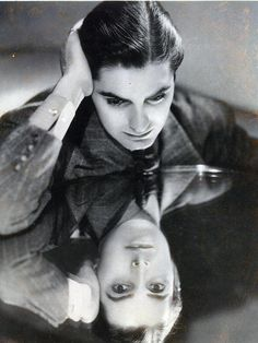 Tyrone Power, 1930s- the pose is like Narcissus looking at his reflection. Wonder if the photographer knew that?