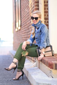 Autumn Olive: J. Crew distressed denim cropped jacket, cuffed sleeves, popped collar, olive track pants, tapered track pants, leopard ankle strap heels, Kate Spade colorblock bag, black Chanel cateye sunglasses, fall outfit, track pants with heels
