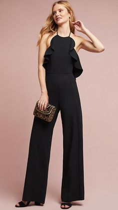 Yes, you can wear a jumpsuit as a wedding guest! We've picked the best dressy jumpsuits for special occasions, along with attire guidelines for how to style them what kind of jumpsuits to avoid! Black Jumpsuit Outfit, Black Romper Pants, Pant Romper Outfit, Jumpsuit Dressy, Black Tie Wedding Guests, Jumpsuit For Wedding Guest, Black Tie Attire, Rompers Dressy, Dressy Outfits