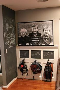 chalk board wall and backpack hangers for the kids. Love one big pic of kids above their hooks. #mudrooms #organizing #decor