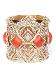 Bold and beautiful and…kind of badass, too. This stunning statement cuff harkens back to the jazzy Twenties with its graphic Art Deco patterns—made even glitzier with a bevy of crystals—but it also flaunts gorgeous carnelian-like stones in deep blood-red.