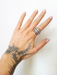What does plant tattoo mean? We have plant tattoo ideas, designs, symbolism and we explain the meaning behind the tattoo. Leaf Tattoos, Body Art Tattoos, Small Tattoos, Girl Tattoos, Sleeve Tattoos, Tatoos, Female Hand Tattoos, Forearm Tattoos, Temporary Tattoos