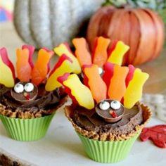 Thanksgiving School Crafts and Treats Inspiration board by Bella Bella Studios~Turkey Cupcake... easy and cute-makes a great school treat.  #thanksgiving  #kids #pilgrims #turkey #lollipop #schooltreat #candycorn #fish #cupcake