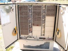 Photo of a common type of cross-box (X-box) used in telephone company Outside Plant. X-boxes are sometime called SAI (Serving Area Interface) boxes. Telephone Exchange, Cable Internet, Outside Plants, Phone Companies, Vintage Telephone, Instructional Design, Old Phone, Lineman, Techno