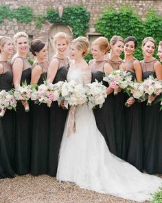 An Elegant Southern Wedding At Home   Martha Stewart Weddings - Brooke's nine bridesmaids, clad in Amsale gowns, clutched smaller, pinker versions of her bouquet. The bride wore a Chantilly-lace gown and jacket, custom-designed by Nardos Imam.