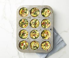 Meal prep these healthy egg muffins for a quick, on-the-go breakfast all week.These easy spinach egg muffins contain the ultimate trio: Protein-packed eggs, nutrient-rich veggies, and flavorful goat … Healthy Muffin Recipes, Healthy Muffins, High Protein Recipes, Easy Healthy Breakfast, Healthy Breakfasts, Banting Breakfast, Eating Healthy, Healthy Meals, Healthy Life