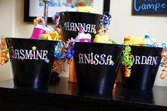 Birthday party favors, dollar store buckets, scrapbook stickers, alphabet, personalized party gift