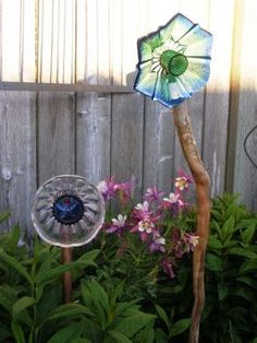 Garden Flowers made out of glass bowls, candle holders, ashtrays, plates, knobs, tins anything that can transform into a flower. repurposed-recycled-upcycled-garden-art