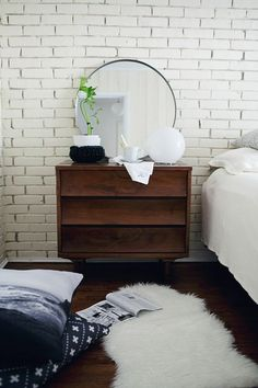 Classic painted white brick wall and straight line wooden side table create a mid-century feel to the bedroom ambiance. Photographed by Heidi Geldhauser. Furniture, House Design, Home, Home Bedroom, Bedroom Interior, House Interior, Bedroom Inspirations, Interior Design, Home And Living