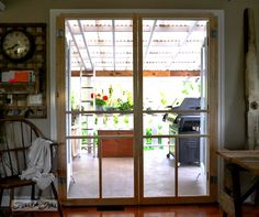 Installing screen doors on french doors... easy and cheap! via Funky Junk Interiors